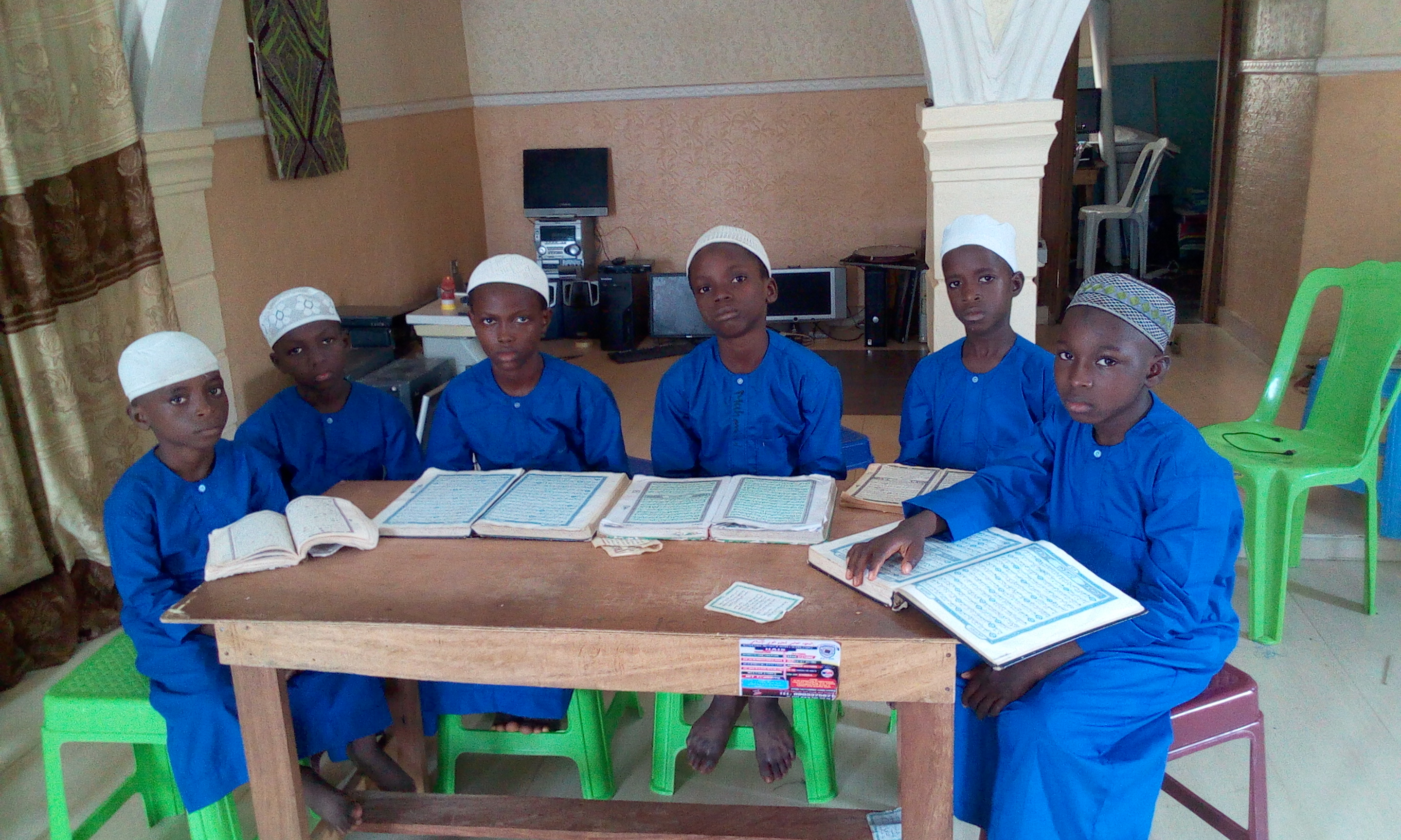 STUDENTS ARE REVISING THEIR QUR'AN IN THE HOSTEL